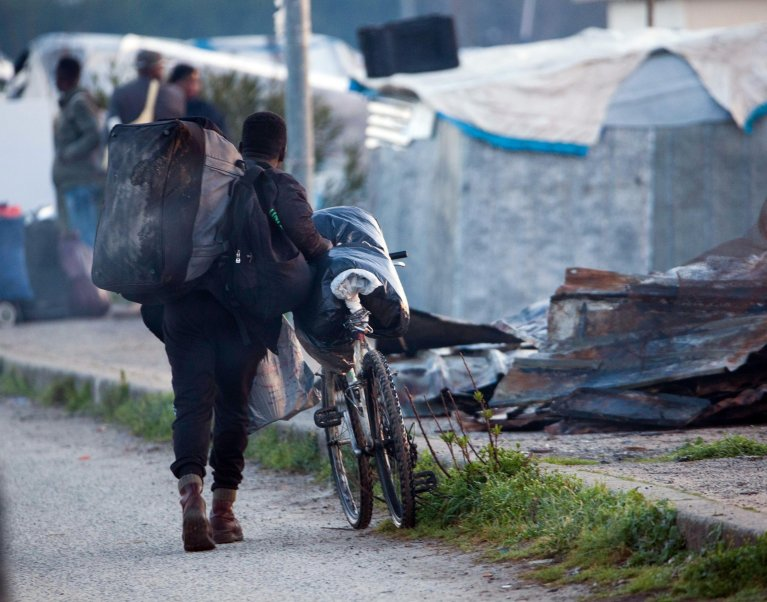 From file: A migrant walking down a street near the San Ferdinando shanty town, in the province of Reggio Calabria, March 6, 2019 | Photo: ANSA/Marco Costantino