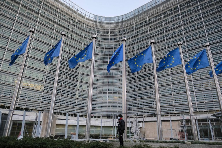 A view of EU flags next to the European Commission in Brussels | Photo: EPA/JULIEN WARNAND