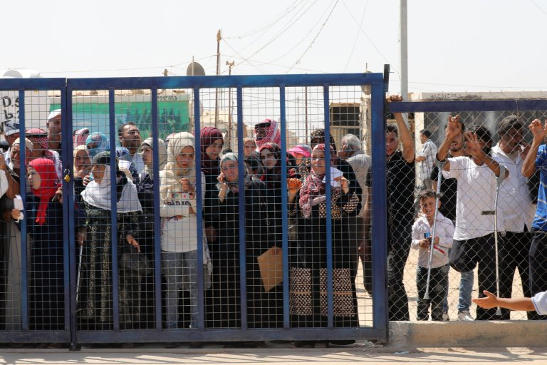 Syrian refugees waiting for their turn to enter a services facility area at the Zaatari refugee camp in Jordan | Credit: EPA