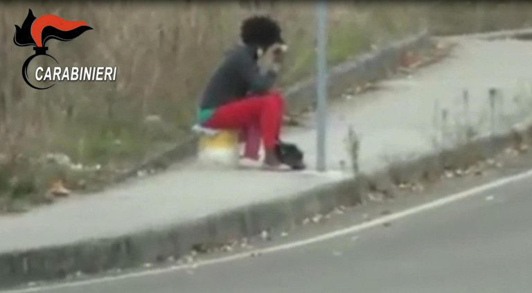 a Nigerian migrant 'caught' in the street after being forced into prostitution. CREDIT: ANSA