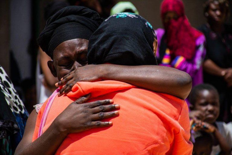 Two migrants hugging | Credit: Hmouzi/IOM Libya