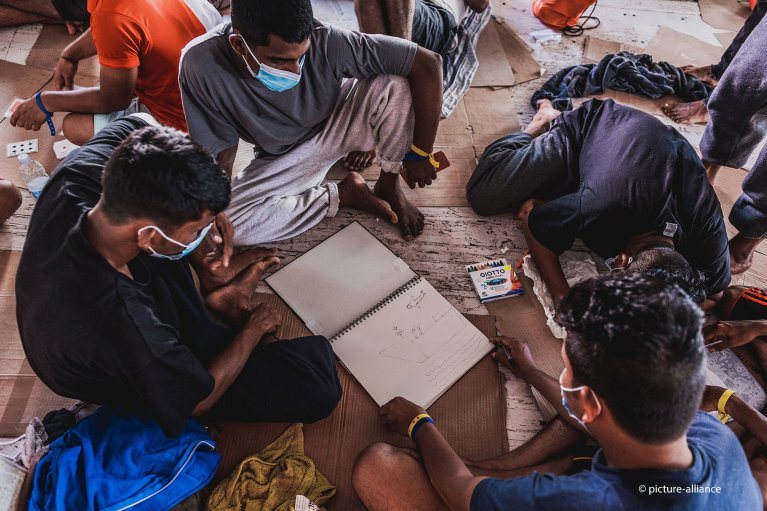 Migrants draw on board the Ocean Viking rescue ship on July 1, 2020 | Photo: Flavio Gasperini/SOS Mediterranee via AP/Picture-alliance