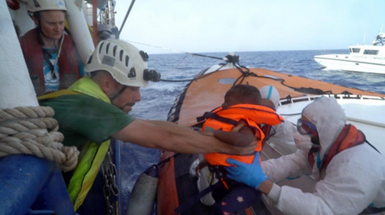 The landing of a little boy, among 10 people authorized to leave the Sea-Watch for Lampedusa, in an image posted by the NGO on its Twitter feed. | Credit: Sea Watch