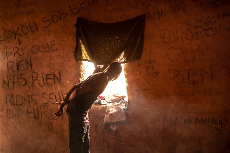 """Migrants and refugees at a secret safe house in an area known as 'The Ghetto"""" of Agadez, Niger. Credit: ANSA/UNICEF"""