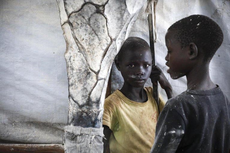 Refugee boys from South Sudan work in a flour mill in Kalobeyei settlement, near Kakuma Refugee Camp in Turkana county, northern Kenya, 24 June 2019 | Photo: EPA/DAI KUROKAWA
