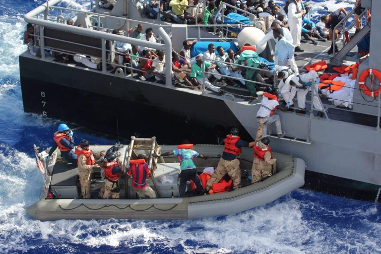 Distressed persons being transferred from the 'USS San Antonio' (LPD 17) to the Armed Forces of Malta (AFM) offshore patrol vessel P52, off the coast of Malta, Mediterranean Sea. (Credit: EPA/Navy Media Content Service/U.S. Navy)