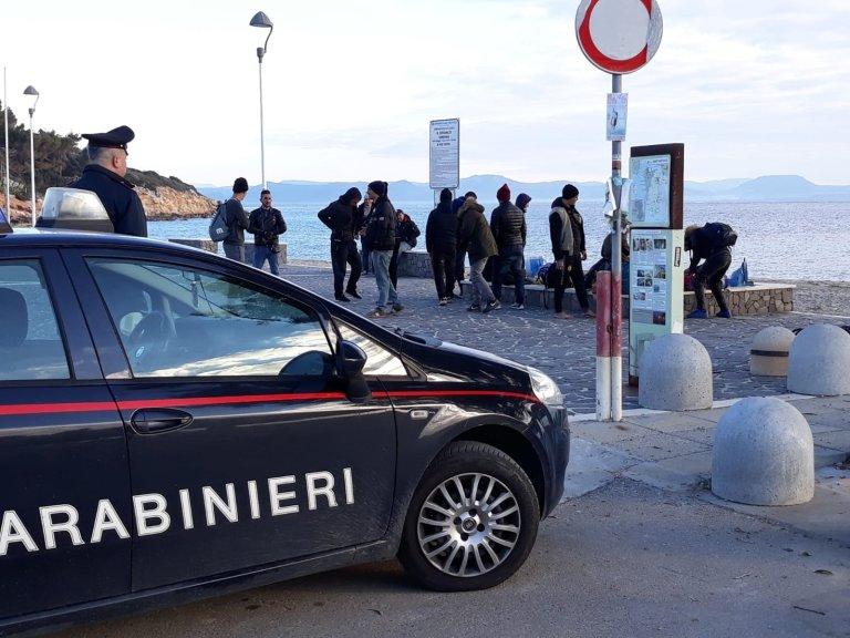 A photo released by Italian carabinieri showing migrants who arrived on the Sulcis coast, southern Sardinia | ANSA / US CARABINIERI