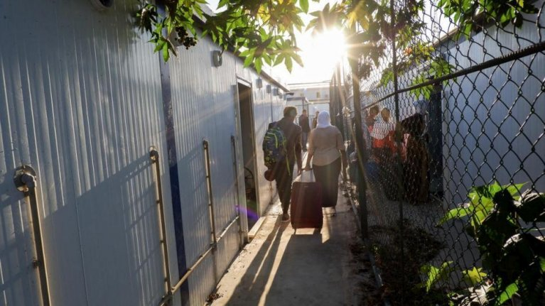 Refugees released from detention arrive at the newly opened Gathering and Departure Facility in Tripoli. | Photo: UNHCR / Farah Harwida