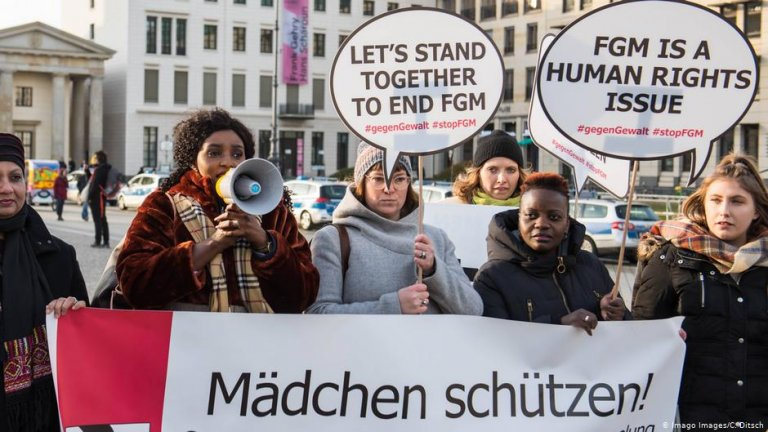 """A 2019 protest by the Terre des Femme NGO in Berlin. The main German-language banner reads: 'Protect girls!""""   Photo: Imago Images/C.Ditsch"""