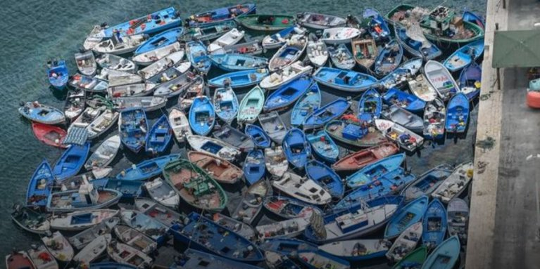 Boats used by migrants in a port in Italy | Photo (via DW): Getty Images/F.Villa