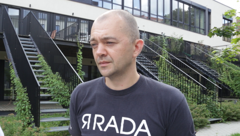 Vytis Jurkonis, Project Director of Freedom House's Vilnius Office, says Lithuania does not have sufficient infrastructure to deal with the migrants Belarus is sending across the border   Screenshot from InfoMigrants video