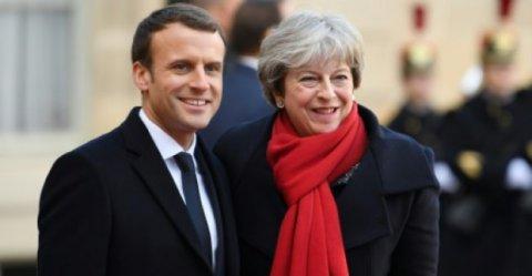 الرئيس الفرنسي إيمانويل ماكرون ورئيسة الوزراء البريطانية تيريزا ماي
