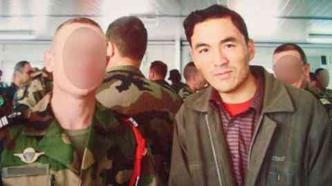 An Afghan army worker who now lives in France poses alongside a French soldier in Afghanistan. | Photo: Abdul Raziq Adel