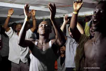 Migrants on the Open Arms celebrate after being allowed to disembark | Photo: Pictuura-alliance