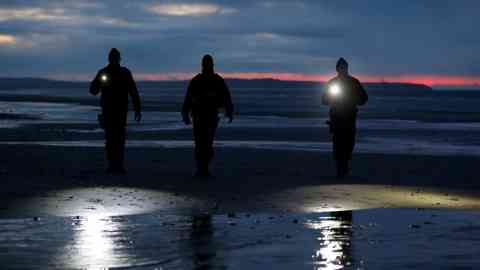 Police patrol the beach near Calais to stop people attempting to cross the Channel | Photo: Reuters / Pascal Rossignol