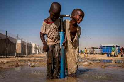 Children play under a water tap during recess at a UNICEF-supported primary school inside Bukasi Internally Displaced People's camp in Maiduguri, Nigeria on February 28, 2017   Photo: ANSA/UNICEF
